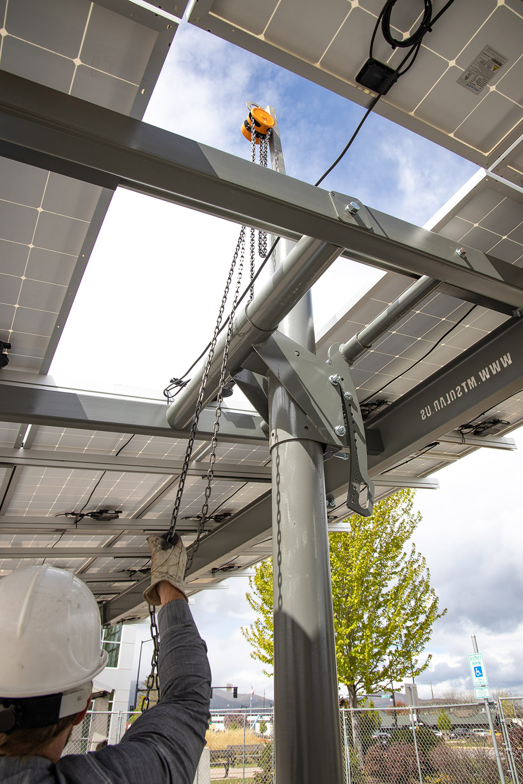 chain hoist raising solar panels